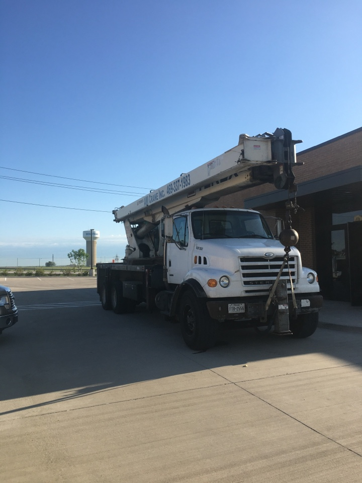 Midlothian, TX - Starting the day at Midlothian. Crane onsite to help lift our roof top heating and cooling units.
