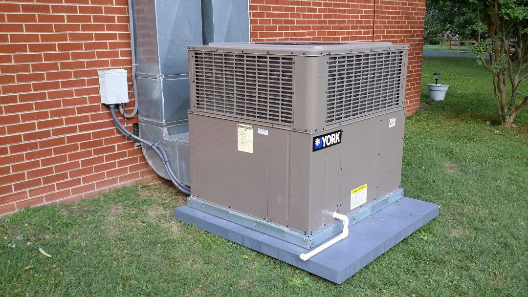 Installed York 3.5 Ton 14 Seer Package Heat Pump System in South Knoxville today in the hot sun. Another happy customer!