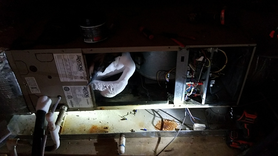 Sevierville, TN - Working on a frozen Armstrong Heat Pump unit in a crawl space in Sevierville.