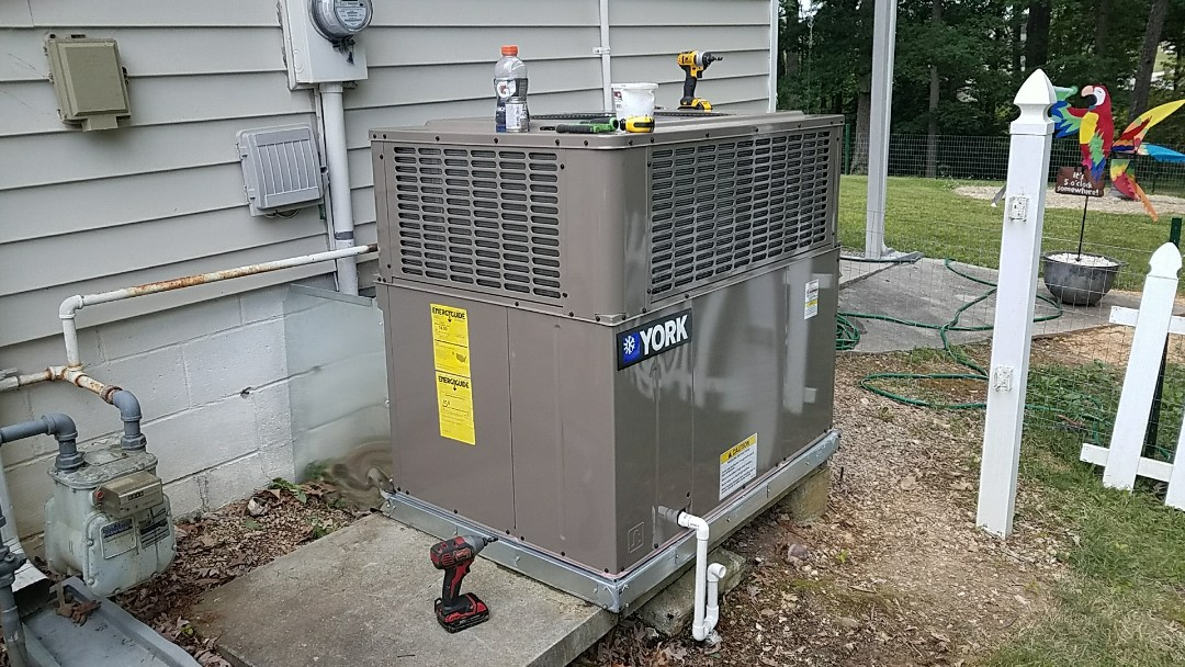 Installing New York 3 Ton Gas Package unit in Seymour.
