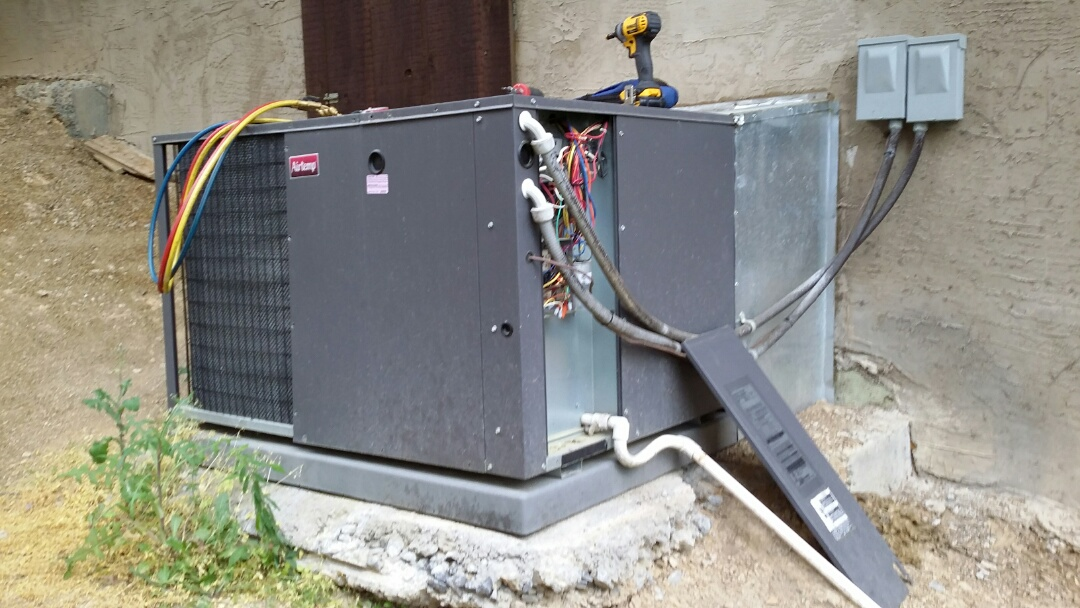 Doing Tune Up on AirTemp 3.5 Ton heat pump package unit in Sevierville.