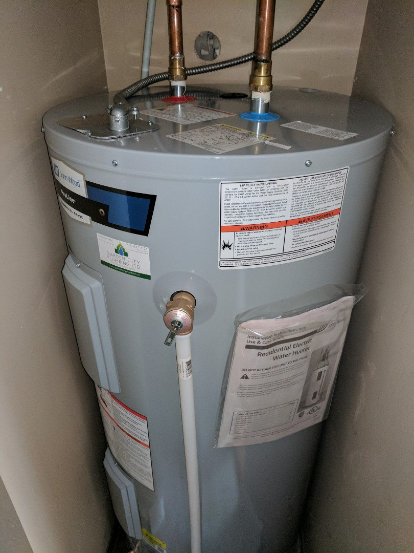 Victoria, BC - Installing an electric Hot water heater for homeowner in Saanichton