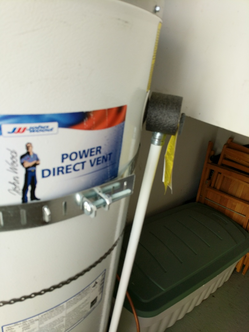 Victoria, BC - Installing earthquake straps on gas hot water heater for home owner in Gordon Head