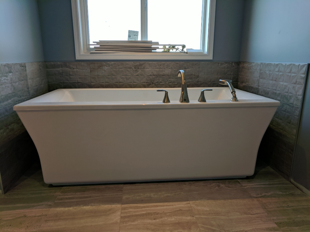 Victoria, BC - Installing freestanding tub for homeowners renovation in Cordova Bay