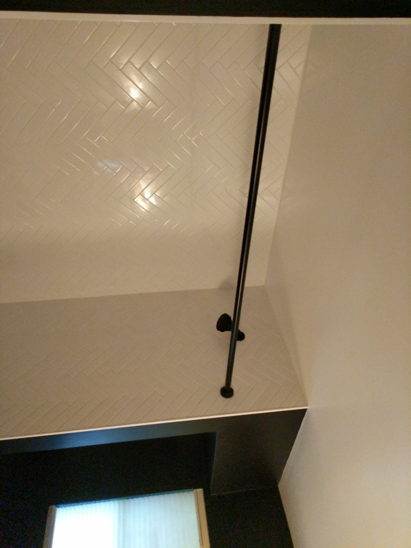 Victoria, BC - Installing curtain rod for client in oak bay