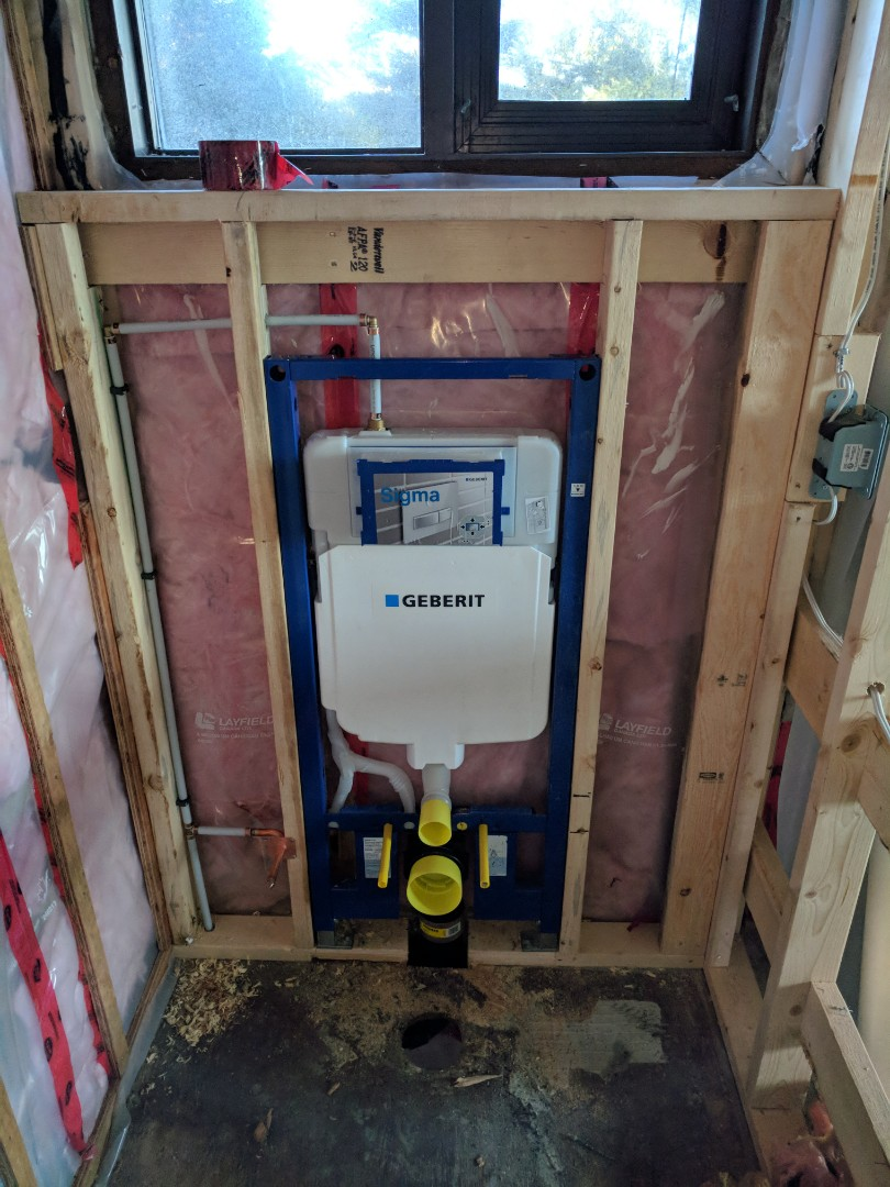 Victoria, BC - Installing wall-hung toilet carrier and custom home in Cordova Bay