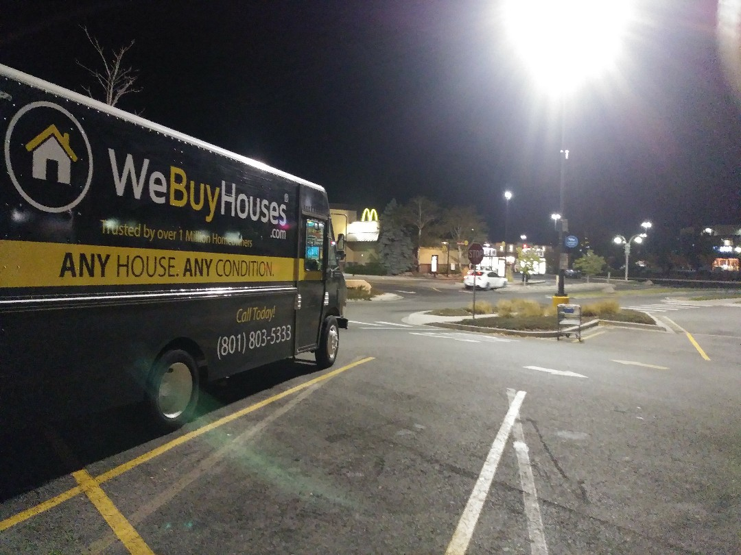 Taylorsville, UT - I just completed a short notice structural reconfiguration for in the home office of a close business associate of the WeBuyHouses.com team. A step in a renovation was overlooked and I was happy to be able to correct that quickly for him. I've pulled the WeBuyHouses.com multi-task service van into Wal Mart parking lot to tidy up some paperwork and refill the snack drawer before heading to the next job. I park near the main road to make folks aware that we buy ANY HOUSE, ANY CONDITION....FAST !!