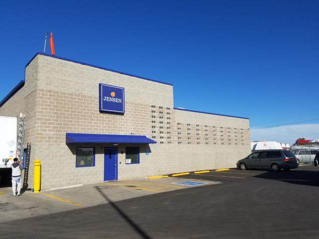 Brighton, CO - Serious transformation of the Jensen Food Plant in Brighton, CO.  Exterior painting of commercial building, including awnings, steel doors, wall cap and roof flashing to match new branding colors.