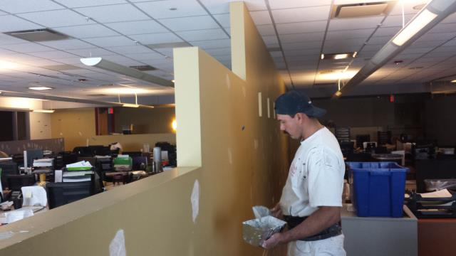 Broomfield, CO - Painters are working hard on drywall repairs at this commercial interior office painting project.  There are over seven different accent colors matched to perfection with Sherwin Williams ProMar 200 interior latex paint.
