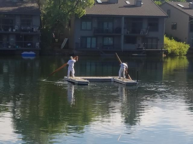 Englewood, CO - Our painters will go to any extreme to get the job done!Replaced siding, trim and painted these multi-family condominiums using Behr Marquee exterior latex.  The only way to get to the lake side was to work off of a dock.  No motorized boats allowed, so...Some people paddle board for sport, these guys get paid.