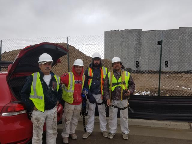 Aurora, CO - The commercial paint crew ready for an exciting day working at the new Amazon Fulfillment Center in Aurora.