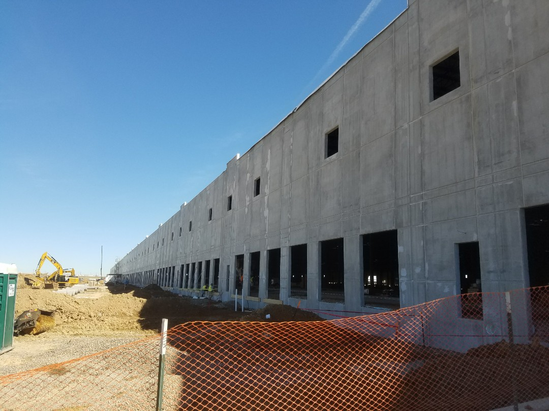 Aurora, CO - Preparing for masonry painting on this commercial interior with Benjamin Moore primer and Eco-spec paint.
