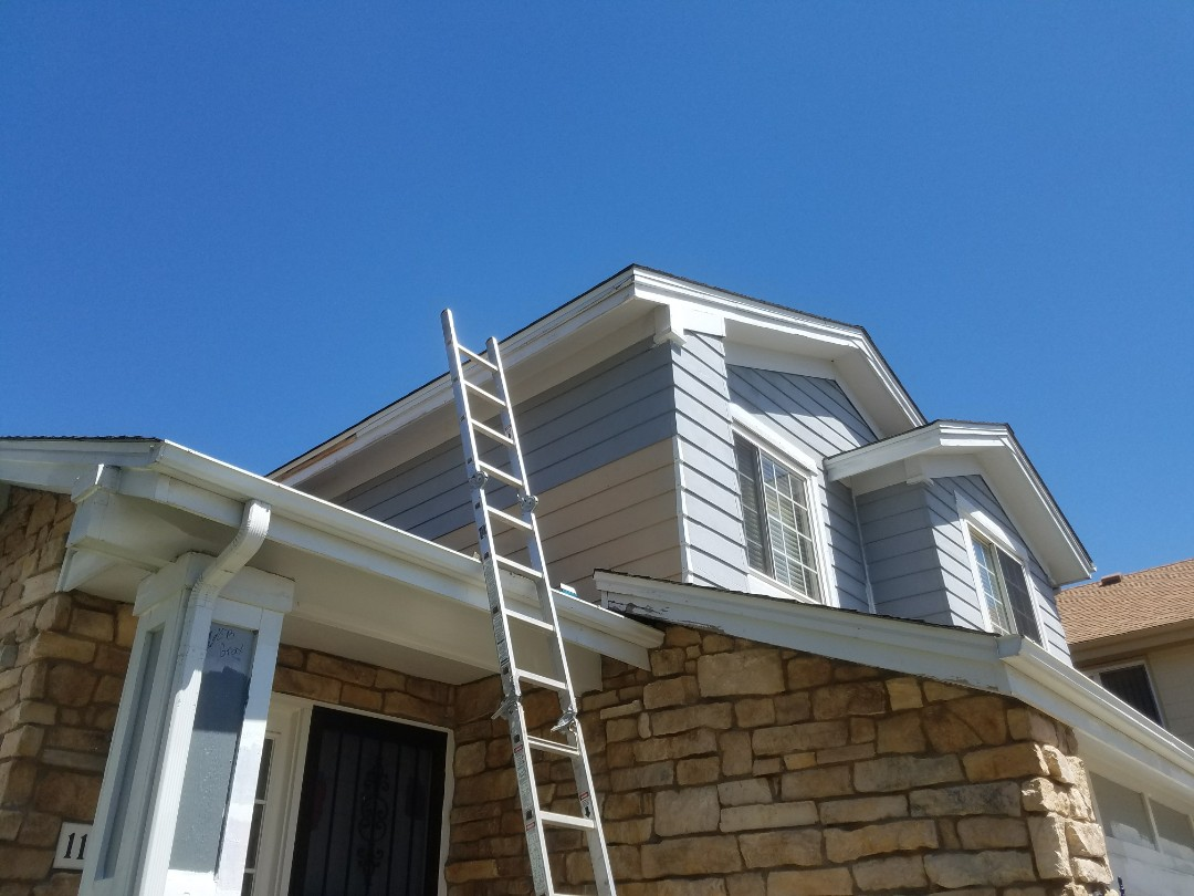 Arvada, CO - Carpenters doing siding replacement prior to paint on a home in Arvada.