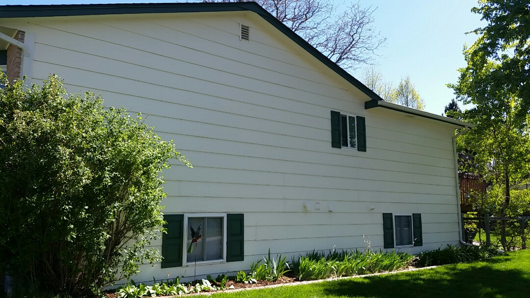 Arvada, CO - Giving an estimate on to paint the exterior this beautiful Arvada home using Sherwin Williams Super paint