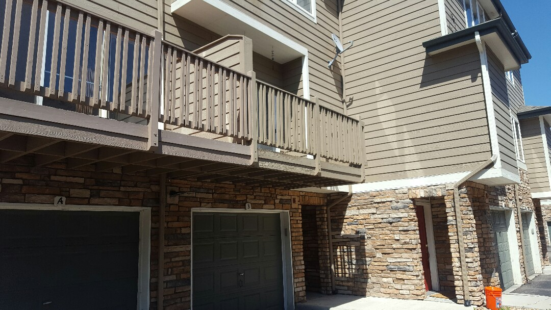 Littleton, CO - Canterbury balcony restoration with paint and stain. Littleton, CO