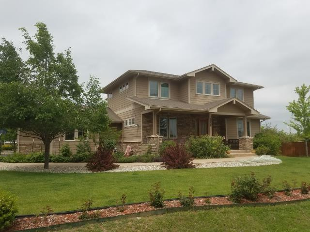 Longmont, CO - Preparing an estimate for exterior paint on this lovely home in Niwot.  Along with exterior painting Colorado Commercial and Residential Painting can provide concrete sealing for the beautiful stamped concrete sidewalk and drive.
