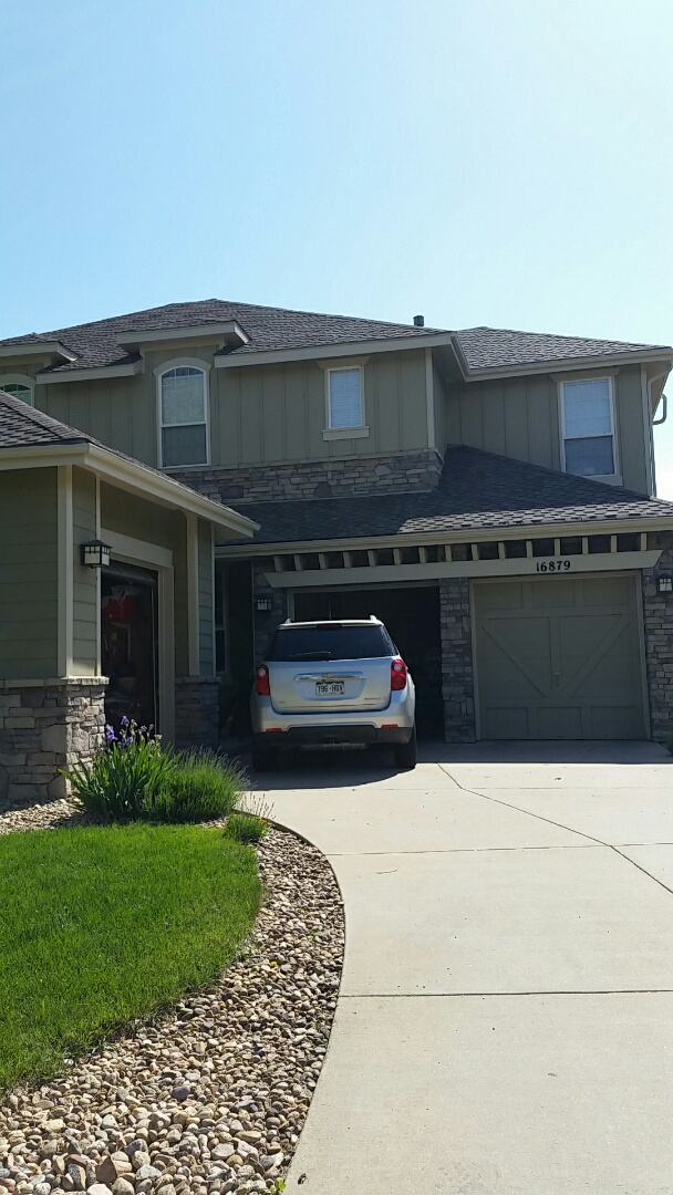 Arvada, CO - Working on a big Arvada home trim only using Sherwin Williams Super paint custom color cashew, looks awesome!