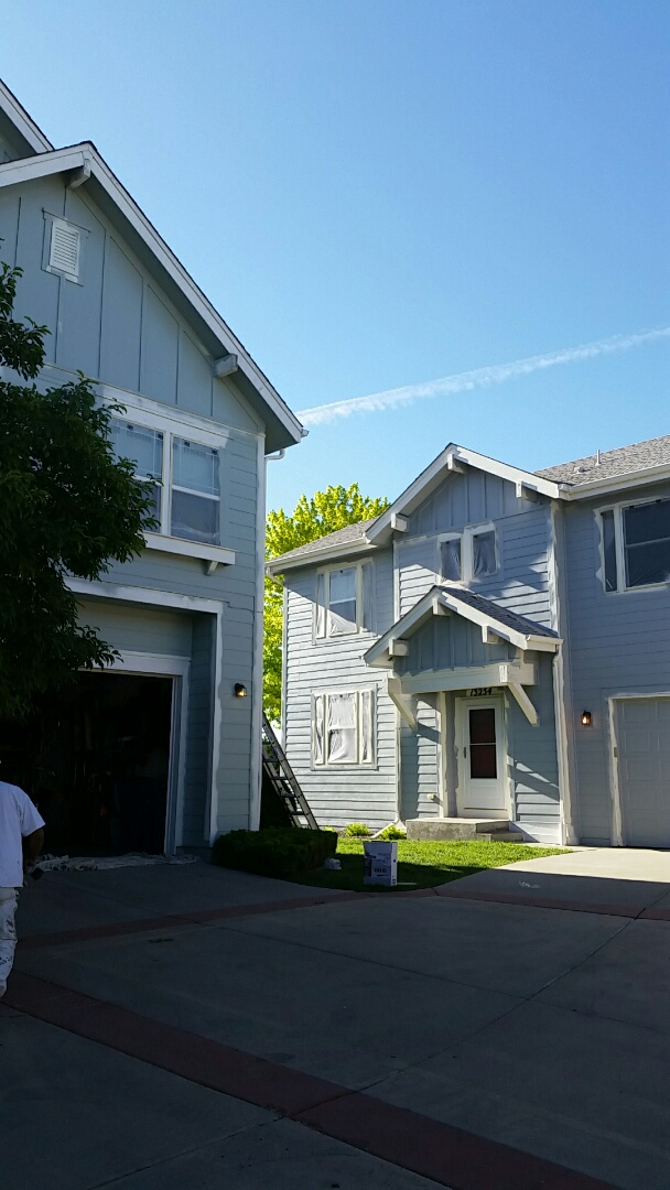 Broomfield, CO - Neighbors that paint together save together! These beautiful Broomfield homes are really coming together. The left with Sherwin Williams Super paint Greek Villa and the right with Sherwin Williams Super paint Foggy Day trim.