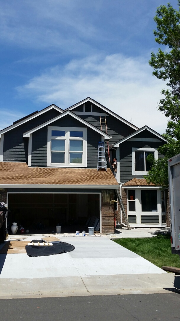 Broomfield, CO - Look at that Sherwin Williams Super paint alabaster pop! The grizzle grey looks phenomenal next to fresh bright trim. This Broomfield home looks brand new and the homeowner loves it!