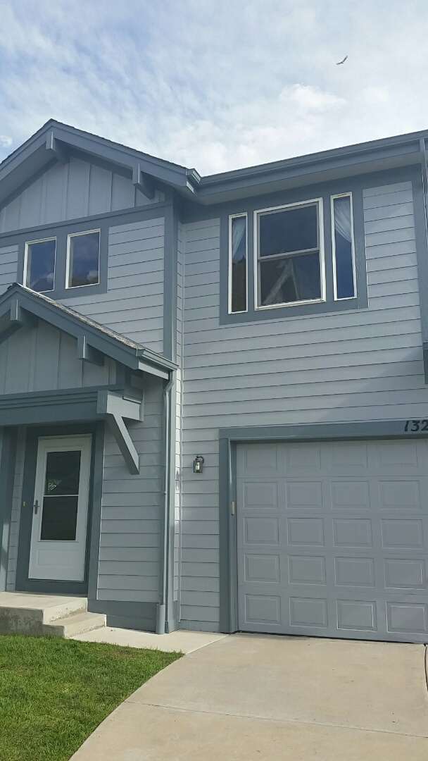 Broomfield, CO - The transformation is complete! Neighbour #2 is done and the homeowner is thrilled! Sherwin Williams uncertain grey with foggy day trim and a bright Commodore blue door! Great job guys!
