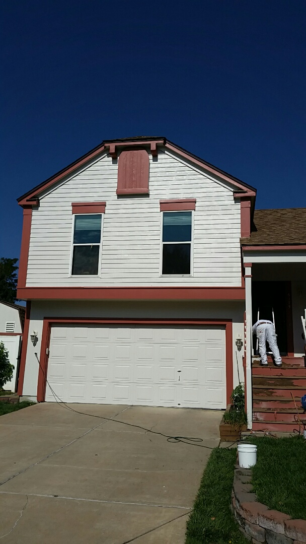 Arvada, CO - The body is done! Bright new Sherwin Williams Super Paint Sad cloud with burnt red trim. Onto the deck and this house is back to life!