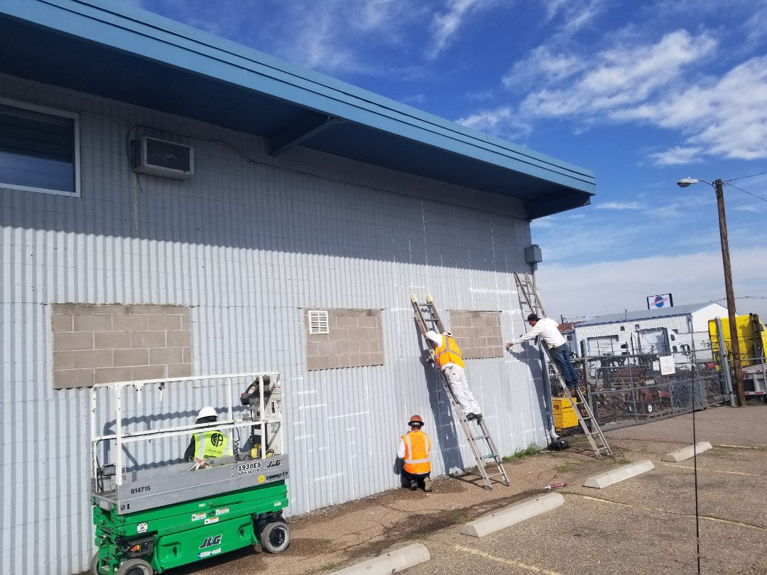 Commerce City, CO - It's the prep that counts! Our commercial painters are starting this Commerce City industrial painting project.  Commercial painting by Colorado Commercial & Residential Painting.