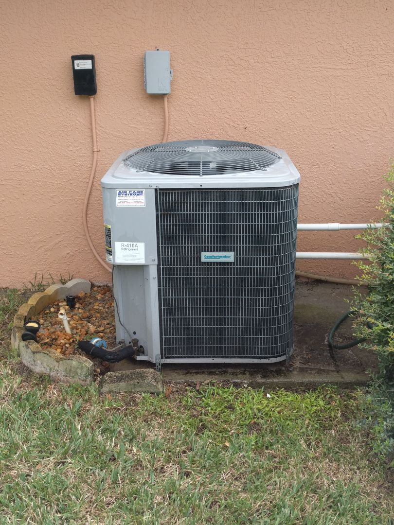 Melbourne, FL - Finishing maintenance on and clearing blocked drain on a Comfort Maker heat pump for a new customer.