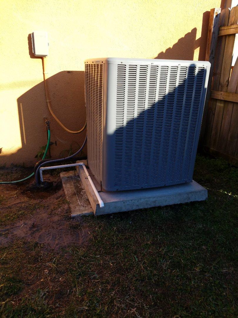Orlando, FL - Performing heat pump service maintenance in Chuluota Florida
