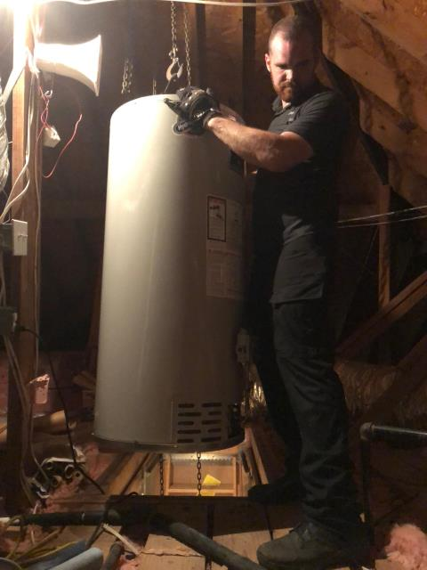 Leaking State Water Heater in attic replaced with Bradford White Water Heater same day for customer in Spring
