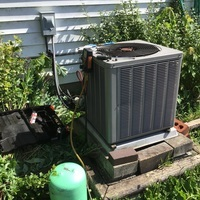 Recharged a 2004 Weather King AC with 3 lbs of R-22 Freon and added Easy Seal.