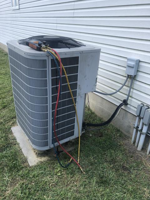 Pataskala, OH - Diagnostic Performed Replaced Thermostat On Bryant AC System To Keep AC Running Efficiently For The Summer Season