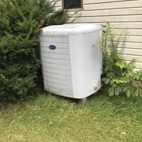 2009 Carrier Heating and Cooling System found leaking water due to a clog. Unclogged the system and repaired the trap kit and installed an overflow pipe. System is no longer leaking water.