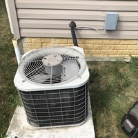 Outdoor capacitor blown on central air system. Advised client that unit has a leak and is low on refrigerant. 2 lbs of R-22 Freon added to unit and replaced the Dual Capacitor 35+5. Cycled system on and confirmed proper cooling upon departure.