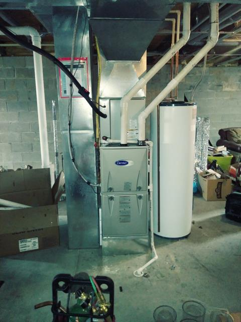 Furnace tune - up and safety check performed on a Carrier system. Confirmed that the system is working within manufacturer specifications.