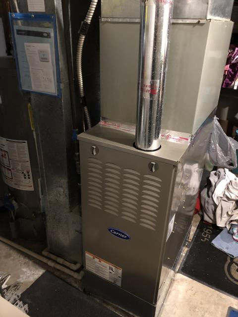 Technician completed a full tune up on the customer's Gas Carrier Furnace to ensure proper heating through out the winter months.  Pictured is the Carrier 80% 90,000 BTU Gas Furnace.