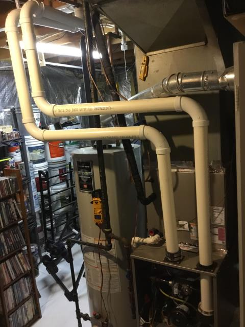 Canal Winchester, OH - The technician diagnosed a Carrier furnace that was blowing cold air. He cleaned the flame sensor, and added a heat shield between the PVC exhaust and the water heater. The technician also removed debris from the the ends of the flue pipes. The system is now operating properly.