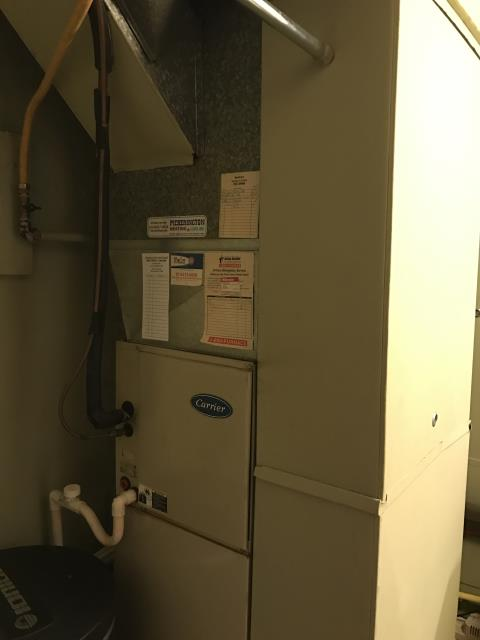 Furnace tune - up and safety check performed on a Carrier 80% 90,000 BTU Gas Furnace unit. Confirmed that the system is working within manufacturer specifications.  Pictured is customer's  Carrier 80% 90,000 BTU Gas Furnace.
