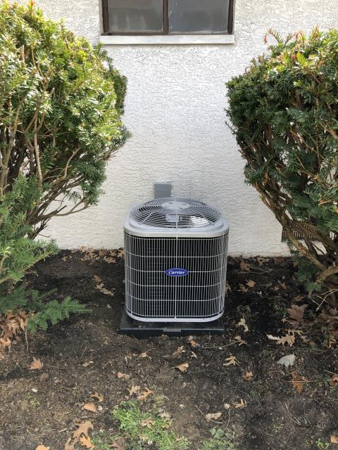 Gahanna, OH - Installing a new Carrier 13 SEER 2 Ton Air Conditioner.