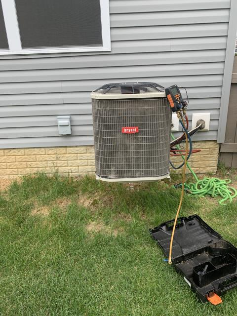 Lithopolis, OH - Customer stated that the 2014 Bryant system was leaking water but still cooling home. Found clog in condensate drain. Cleared clog and tested A/C unit. Temp drop of 17. Pressures are 129/283. Subcool is at 9.9. System working properly.