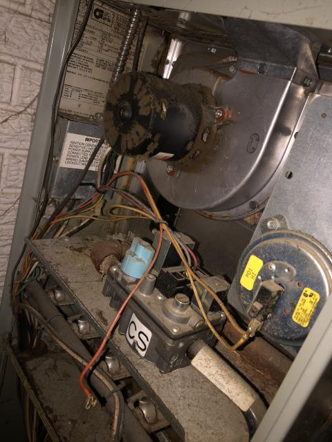 Pickerington, OH - I completed a diagnostic on a Trane gas furnace.  Determined that the blower motor had a vibration and a low capacitor.  The unit is older with dirt, dust, cob webs, debris and rust around the inside of the unit.  I gave the client an estimate to replace the blower motor and capacitor.  I also gave the client an estimate to replace the furnace.  I recommend that due to the age, condition and cost of repairs (seen and unseen) that the unit be replaced.  Client decided to replace the furnace.
