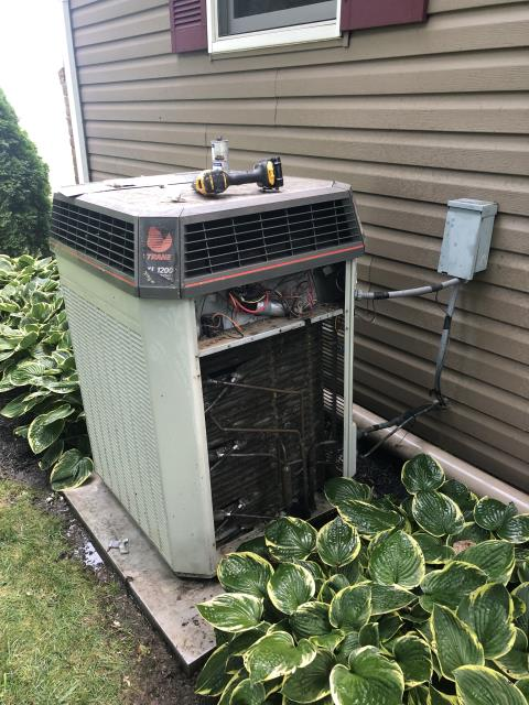 Pataskala, OH - I arrived on site to perform an inspection of a Trane air conditioning unit. During the inspection I found that the unit's capacitor had worn out and the coil was dirty. I cleaned the coil and replaced the capacitor. I also found that the unit's R-22 Refrigerant was low. I refilled the unit's refrigerant and the unit was running at full functionality at the time of departure.