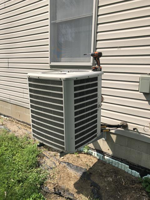 Hebron, OH - I completed a diagnostic on a Goodman Air Conditioner. I determined that the charge was low and the capacitor was bad. I recommend due to condition, age and cost of repairs both seen and unseen that the unit be replaced.
