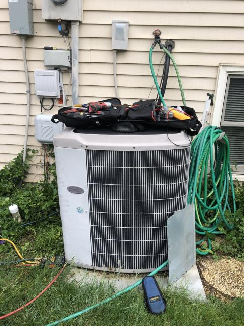 Pickerington, OH - I completed a diagnostic on a AC unit. I checked the Carrier furnace and it was all in good shape. I went to the outside unit and found neither the fan motor or compressor running. I opened the access panel and tested the capacitor with no issues, but found there was no coolant in the unit. Low pressure was detected, reason why the condenser was not working.  I recommended the unit be replaced rather than recharging and leak search.