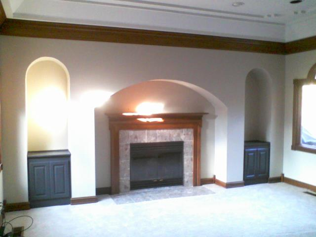 Carmel, IN - Newly painted walls, cabinets and fireplace mantle.