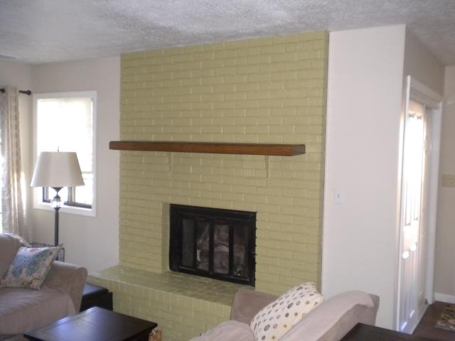 Painted brick around fireplace.