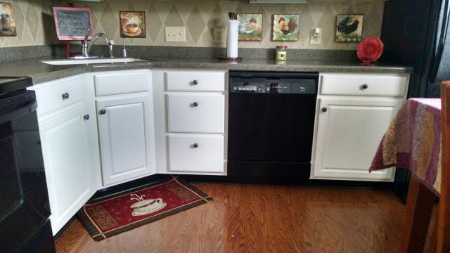 Kitchen cabinets painted white.