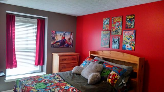Room painted grey with red accent wall.