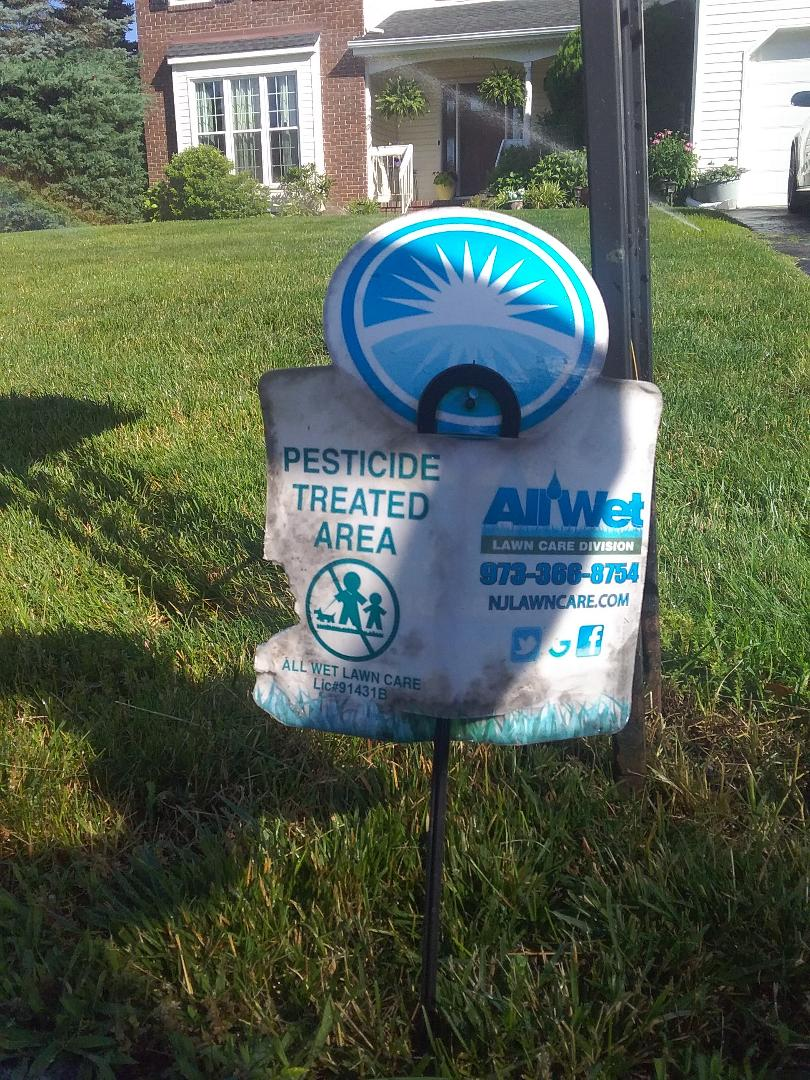 Mount Olive Township, NJ - Applying granulated fertilizer, lime, treating for weeds, insects and grubs, in preparation for seasonal aeration, backed by a green lawn guarantee!!! =)
