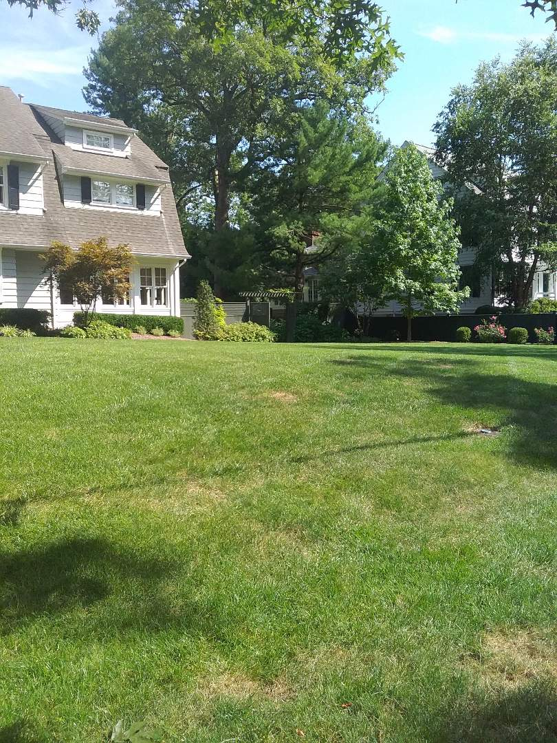 Millburn, NJ - Mid season inspection of the irrigation system increased turf run times do to hot weather