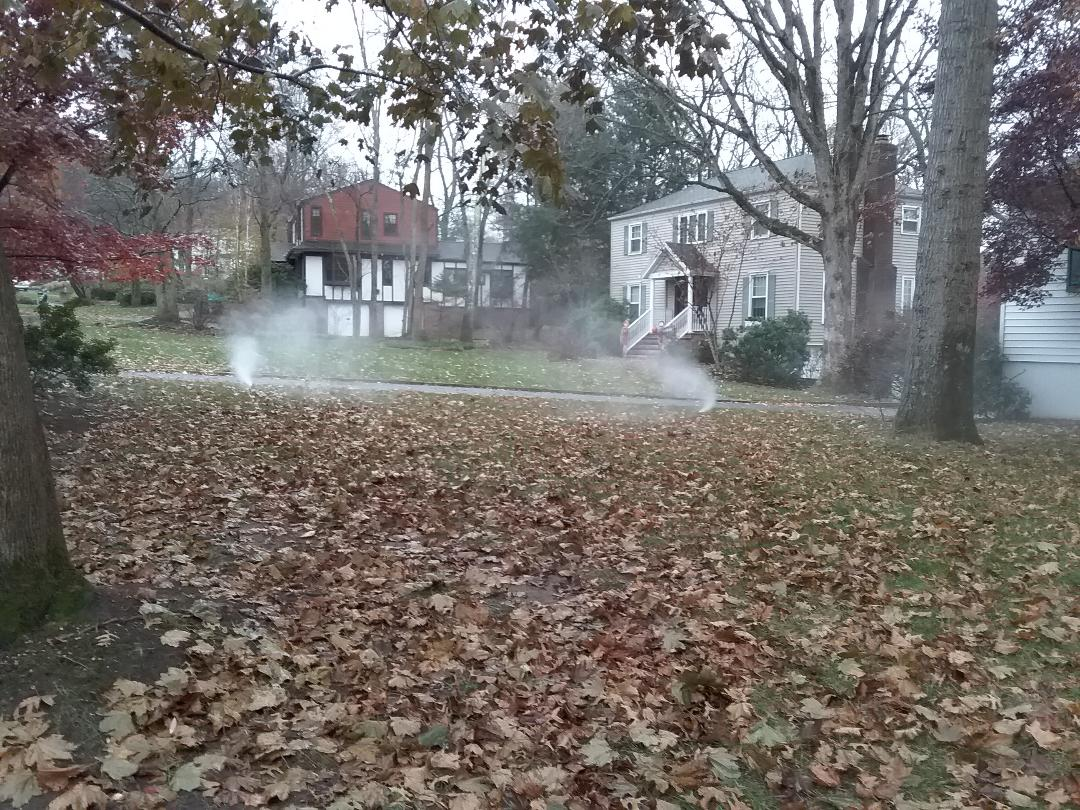 Chatham Township, NJ - Winterizing lawn sprinklers, water and clock are off, draining water by outside hose bib under deck